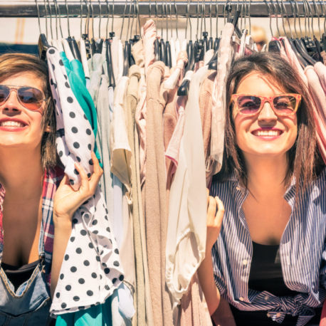 Young beautiful women shopping at the weekly cloth market